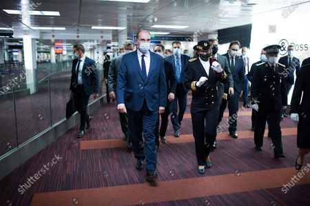 French Junior Minister for Transports Jean-Baptiste Djebbari-Bonnet, French Prime Minister Jean Castex, delegate prefect in charge of Roissy Charles De Gaulle, Bourget and Orly airports' security Sophie Wolfermann and french minister of health Olivier Veran wearing face mask at Roissy-Charles de Gaulle airport, north of during a visit as sanitary measures have been deployed for departing and arriving passengers in order to curb the spread of the COVID-19 pandemic, caused by the novel coronavirus. Europe hit more than three million coronavirus cases on July 23, while spiking infection numbers worldwide led authorities to reimpose restrictions on citizens.