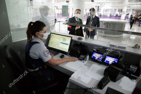 Police forces at customs control at Roissy-Charles de Gaulle airport, north of during a visit as sanitary measures have been deployed for departing and arriving passengers in order to curb the spread of the COVID-19 pandemic, caused by the novel coronavirus. Europe hit more than three million coronavirus cases on July 23, while spiking infection numbers worldwide led authorities to reimpose restrictions on citizens.