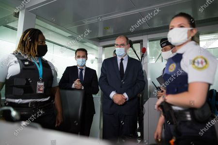 French Prime Minister Jean Castex, French Junior Minister for Transports Jean-Baptiste Djebbari-Bonnet wearing face mask speaks with customs control police forces at Roissy-Charles de Gaulle airport, north of during a visit as sanitary measures have been deployed for departing and arriving passengers in order to curb the spread of the COVID-19 pandemic, caused by the novel coronavirus. Europe hit more than three million coronavirus cases on July 23, while spiking infection numbers worldwide led authorities to reimpose restrictions on citizens.