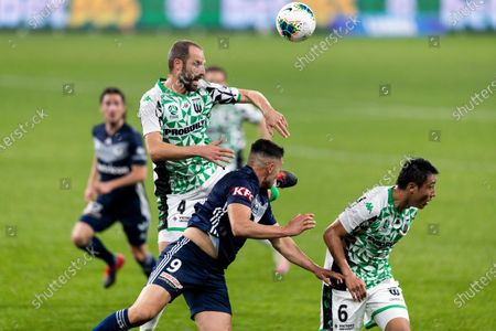 Western United defender Andrew Durante (4) and Melbourne Victory forward Andrew Nabbout (9) up for a header