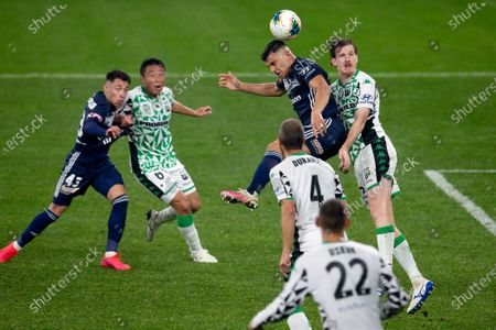 Melbourne Victory forward Andrew Nabbout (9) heads the ball under pressure from Western United defender Aaron Calver (2)