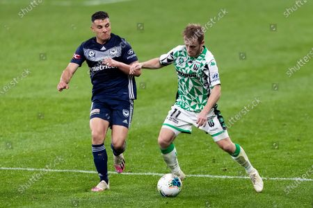 Western United forward Connor Pain (11) attacks as Melbourne Victory forward Andrew Nabbout (9) defends