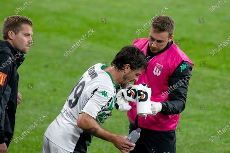 Western United defender Josh Risdon (19) wipes blood from his nose
