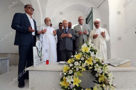 Stock Picture of Tunisia's Parliament Speaker Rached Ghannouchi (C) prays during the fhe first anniversary of the death of former President Beji Caid Essebsi at El-Jellaz cemetery in a suburb of Tunis, Tunisia, 25 July 2020. On 27 July 2019 Tunisia's former president, Beji Caid Essebsi died aged 92 at the military hospital in Tunis.
