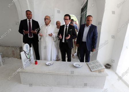 Stock Image of Tunisians pray during the the first anniversary of the death of former President Beji Caid Essebsi at El-Jellaz cemetery in a suburb of Tunis, Tunisia, 25 July 2020. On 27 July 2019 Tunisia's former president, Beji Caid Essebsi died aged 92 at the military hospital in Tunis.