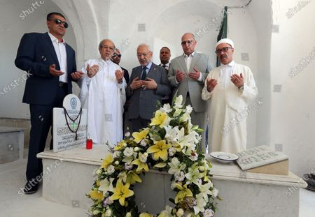 Tunisia's Parliament Speaker Rached Ghannouchi (C) prays during the fhe first anniversary of the death of former President Beji Caid Essebsi at El-Jellaz cemetery in a suburb of Tunis, Tunisia, 25 July 2020. On 27 July 2019 Tunisia's former president, Beji Caid Essebsi died aged 92 at the military hospital in Tunis.