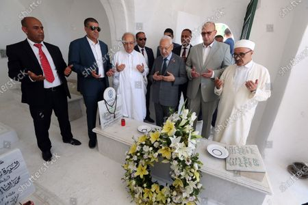 Tunisia's Parliament Speaker Rached Ghannouchi (3-R) prays during the fhe first anniversary of the death of former President Beji Caid Essebsi at El-Jellaz cemetery in a suburb of Tunis, Tunisia, 25 July 2020. On 27 July 2019 Tunisia's former president, Beji Caid Essebsi died aged 92 at the military hospital in Tunis.