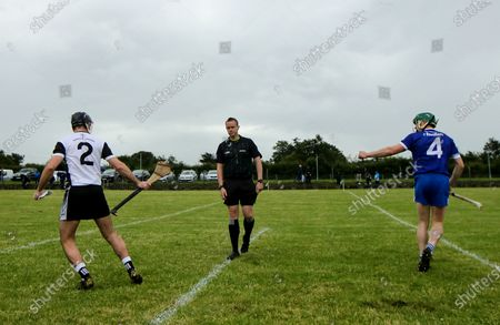 Thurles Sarsfields vs Kilruane MacDonaghs. Referee Michael Kennedy with Kilruane MacDonaghs Captain Eoin Hogan and Thurles Sarsfields Captain Michael Cahill at the coin toss