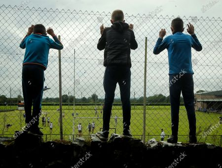 Thurles Sarsfields vs Kilruane MacDonaghs. Fans (L to R) Mark Cleary, Tommy O'Meara and Shane Cleary watch the game from a far