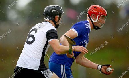 Thurles Sarsfields vs Kilruane MacDonaghs. Kilruane's Darragh Peters and Billy McCarthy of Thurles