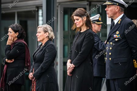 (L to R) Second Chamber President Khadija Arib, Defense Minister Ank Bijleveld, Secretary of Defense Barbara Visser and Commander of the Armed Forces Rob Bauer during a ceremony at Eindhoven Air Base, after the transport aircraft from Curacao arrived with the two killed NH-90 crew members at Eindhoven airbase, Netherlands, 25 July 2020. Netherlands defense ministry said on 20 July that Dutch army helicopter crashed into the sea soon after take-off from the Caribbean island of Aruba, killing aviator Christine Martens and tactical coordinator Erwin Warnies.