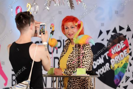 A man takes pictures of the transsexual actress Zazie de Paris during a break of a livestream of the Christopher Street Day Berlin Pride at the Haus der Statistik in Berlin, Germany, 25 July 2020. Berlin's pride parade and festival celebrating LGBT people takes place via online streaming due to the coronavirus pandemic.