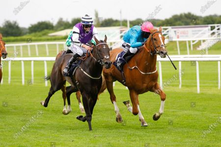 Many A Star and Graham Lee win the Sky Sports Racing Handicap at Doncaster from Foreshore.
