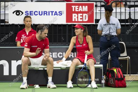 Team captain Severin Luethi, left, talks to Martina Hingis of Switzerland, during a match against Patty Schnyder of Switzerland at the Tennis Securitas Pro Cup in the Swiss Tennis Arena in Biel, Switzerland, 25 July 2020.