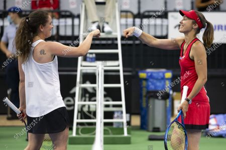 Stock Image of Swiss tennis legends Martina Hingis (R) and Patty Schnyder fist bump after their match  at the Tennis Securitas Pro Cup in the Swiss Tennis Arena in Biel, Switzerland, 25 July 2020.