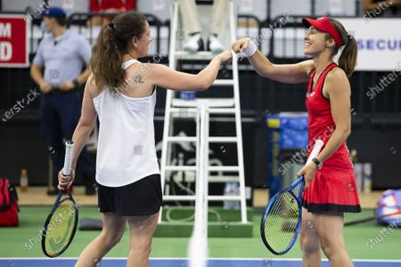 Stock Photo of Swiss tennis legends Martina Hingis (R) and Patty Schnyder fist bump after their match  at the Tennis Securitas Pro Cup in the Swiss Tennis Arena in Biel, Switzerland, 25 July 2020.