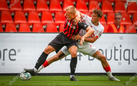 Nice's Kasper Dolberg and Standard's Mergim Vojvoda fight for the ball during a friendly soccer game between Standard de Liege and OGC Nice, Saturday 25 July 2020 in Liege, in preparation of the upcoming 2020-2021 Jupiler Pro League season.