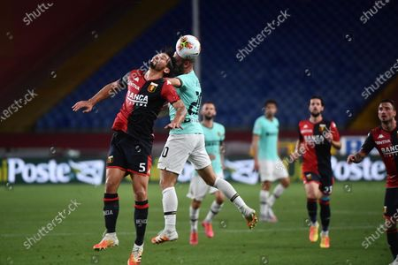 Genoa's Edoardo Goldaniga (L) and Inter's Borja Valero (R) in action during the Italian Serie Serie A soccer match Genoa Cfc vs Fc Inter at Luigi Ferraris stadium in Genoa, Italy, 25 July 2020.