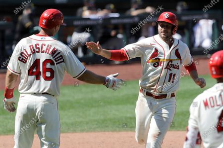 St. Louis Cardinals' Paul DeJong (11) celebrates with Paul Goldschmidt (46) after both players scored on a double by Matt Carpenter during the eighth inning of a baseball game against the Pittsburgh Pirates, in St. Louis. The Cardinals won 9-1
