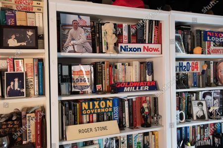 Photo of William F. Buckley on the top shelf of a bookcase in Roger Stones office. Former President Richard and Pat Nixon. Roger Stone relaxes in his office surrounded by a lot of his memorabilia, that he's collected over the years to include former President Nixon. Roger Stone also has a very large book collection and has read all the books in his library. Residence of Roger Stone