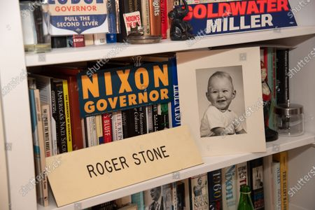 Photo of Roger Stone as a baby. sits on a shelf of his bookcase in his office.  Roger Stone relaxes in his office surrounded by a lot of his memorabilia, that he's collected over the years to include former President Nixon. Roger Stone also has a very large book collection and has read all the books in his library. Residence of Roger Stone