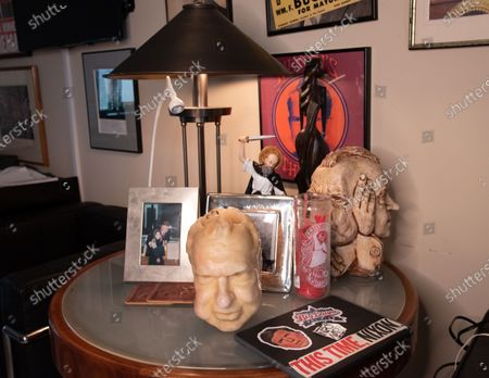 Stock Image of A candle of former President Richard Nixons head. Roger Stone relaxes in his office surrounded by a lot of his memorabilia, that he's collected over the years to include former President Nixon. Roger Stone also has a very large book collection and has read all the books in his library. Residence of Roger Stone