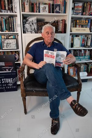 Roger Stone is seated in his office reading 'The Trial of Roger Stone' by Milo Yiannopoulos. Roger Stone relaxes in his office surrounded by a lot of his memorabilia, that he's collected over the years to include former President Nixon. Roger Stone also has a very large book collection and has read all the books in his library. Residence of Roger Stone