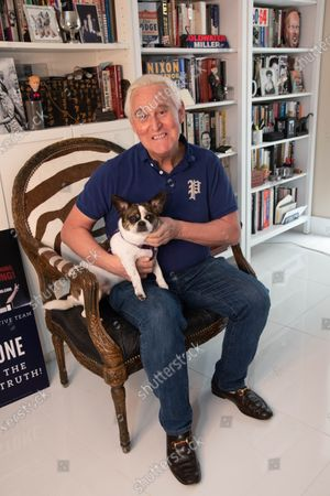 Roger Stone is seated in his office with his dog Jackson. Roger Stone relaxes in his office surrounded by a lot of his memorabilia, that he's collected over the years to include former President Nixon. Roger Stone also has a very large book collection and has read all the books in his library. Residence of Roger Stone