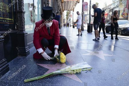 Gregg Donovan, unofficial ambassador of Hollywood, lays flowers on Regis Philbin's star on the Hollywood Walk of Fame, in the Hollywood area of Los Angeles. Philbin has died at age 88