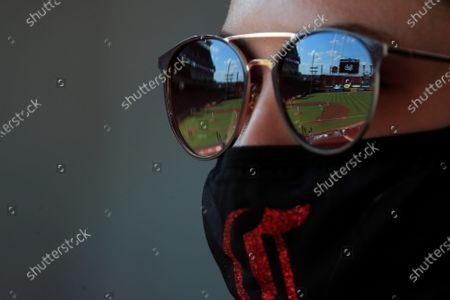 View of the stadium in the reflection of sunglasses worn by Carter Kennedy during a baseball game between the Detroit Tigers and the Cincinnati Reds at Great American Ballpark in Cincinnati, . The Tigers won 6-4