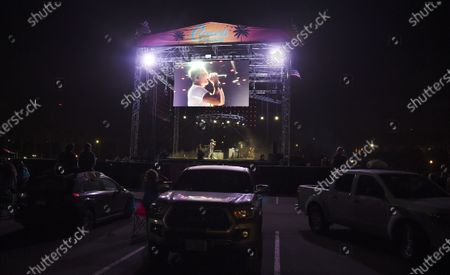 Lead singer Stephan Jenkins is shown on a video screen above the stage as audience members watch Third Eye Blind's performance at Concerts in your Car at the Ventura County Fairgrounds, in Ventura, Calif