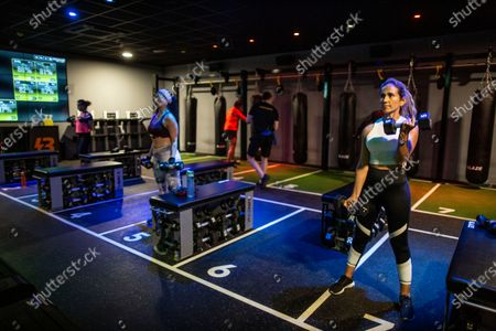 Members workout in one of the studio classes held at David Lloyd Hampton club as it opens its gym and swimming pools at midinight for the first time since lockdown for members.