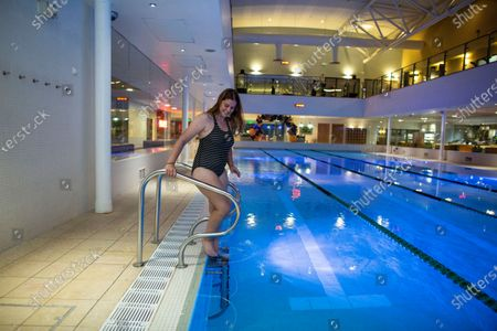 Lisa Phillips the first swimmer to go for a swim at David Lloyd Hampton club as it opens its gym and swimming pools at midinight for the first time since lockdown for members.