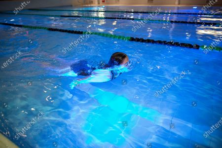 Stock Photo of Lisa Phillips the first swimmer to go for a swim at David Lloyd Hampton club as it opens its gym and swimming pools at midinight for the first time since lockdown for members.