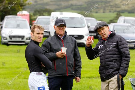 Stock Image of Tom Scudamore with father Peter Scudamore [right] and Donald McCain relaxing at the Cartmel races.