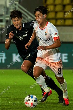 Stock Picture of Kim Hyun-sung of Seongnam FC competes for the ball with Lee Jae-Kwon of Gangwon FC during 2020 K League 1 match between Gangwon FC and Seongnam FC at the tancheon stadium in Seongnam, South Korea, on July 25, 2020.