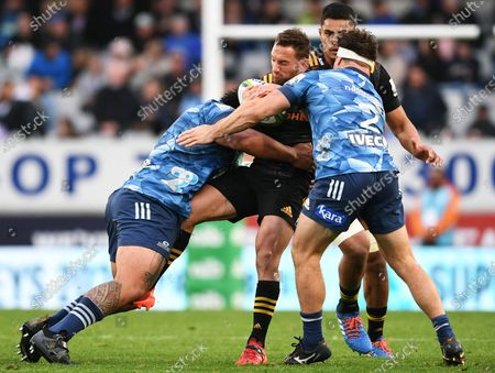 Blues vs Chiefs. Chiefs' Aaron Cruden is tackled by Ofa Tuungafasi of the Blues