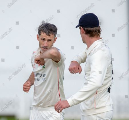 Stock Image of Lancashire CCC bowler Graham Onions bumps elbows to safely celebrate a wicket