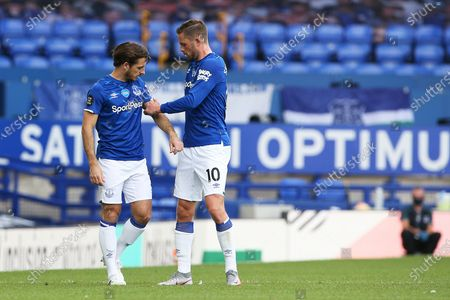Stock Image of Everton midfielder Gylfi Sigurdsson (10) gives Everton defender Leighton Baines (3) the captains armband for the last time during the Premier League match between Everton and Bournemouth at Goodison Park, Liverpool