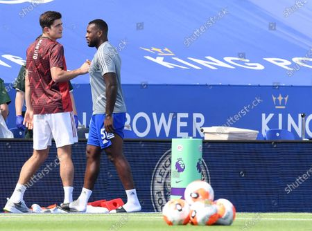 Manchester United's Harry Maguire, left, speaks with Leicester's Wes Morgan before the English Premier League soccer match between Leicester City and Manchester United at the King Power Stadium, in Leicester, England