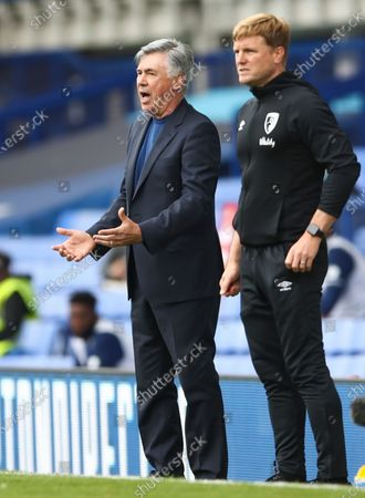 Everton's manager Carlo Ancelotti (L) reacts next to Manager of A.F.C. Bournemouth Eddie Howe (R) during the English Premier League soccer match between Everton and AFC Bournemouth in Liverpool, Britain, 26 July 2020.