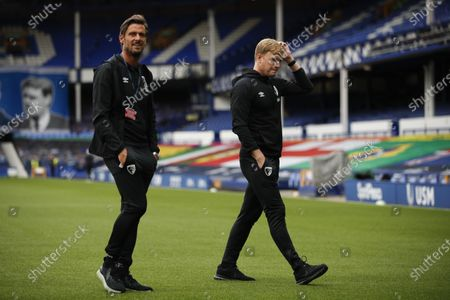Bournemouth's manager Eddie Howe, right, inspects the pitch before the English Premier League soccer match between Everton and Bournemouth at Goodison Park in Liverpool, England