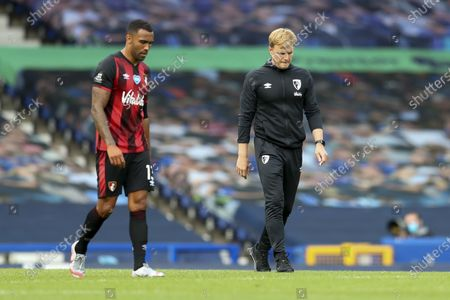 Stock Image of Bournemouth's manager Eddie Howe, right, and Bournemouth's Callum Wilsonwalk off the field their English Premier League soccer match between Everton and Bournemouth at Goodison Park in Liverpool, England