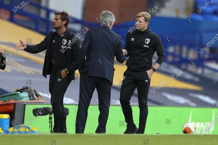 Bournemouth's manager Eddie Howe, right, and Everton's manager Carlo Ancelotti meet field after their English Premier League soccer match between Everton and Bournemouth at Goodison Park in Liverpool, England