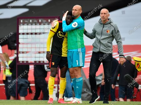 Stock Photo of Watford goalkeeper Heurelho Gomes (R) hugs Watford's Ismaila Sarr (L) after the English Premier League match between Arsenal London and Watford in London, Britain, 26 July 2020.