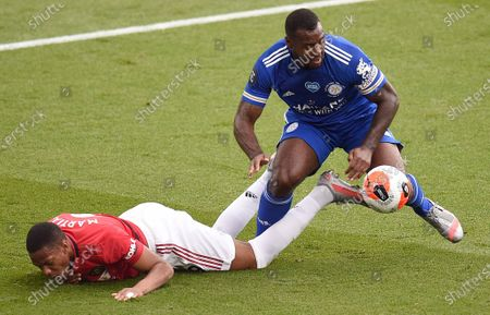 Manchester United's French striker Anthony Martial (L) vies with Leicester City's English-born Jamaican defender Wes Morgan (R) during the English Premier League football match between Leicester City and Manchester United at King Power Stadium in Leicester, Britain, 26 July 2020.