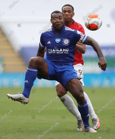 Manchester United's Anthony Martial and Leicester City's Wes Morgan (R) battle for the ball during the English Premier League soccer  match at the King Power Stadium, in Leicester, Britain, 26 July 2020.