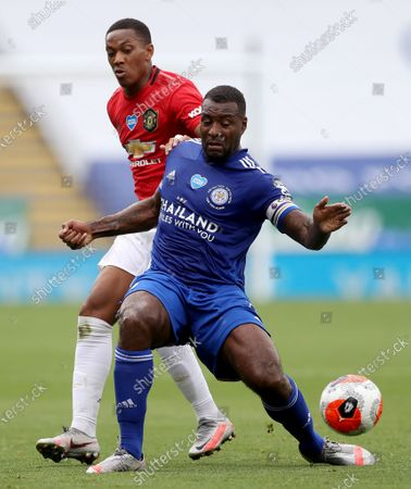 Leicester's Wes Morgan (front) duels for the ball with Manchester United's Anthony Martial during the English Premier League soccer match between Leicester City and Manchester United at the King Power Stadium, in Leicester, Britain, 26 July 2020.