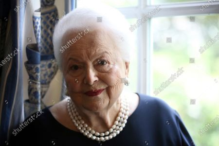 Actress Olivia de Havilland poses during an Associated Press interview, in Paris. Olivia de Havilland, Oscar-winning actress has died, aged 104 in Paris, publicist says