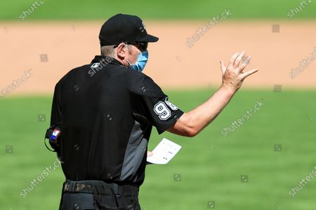 Umpire Chris Conroy (98) signals during a baseball game between the Detroit Tigers and the Cincinnati Reds at Great American Ballpark in Cincinnati, . The Tigers won 3-2